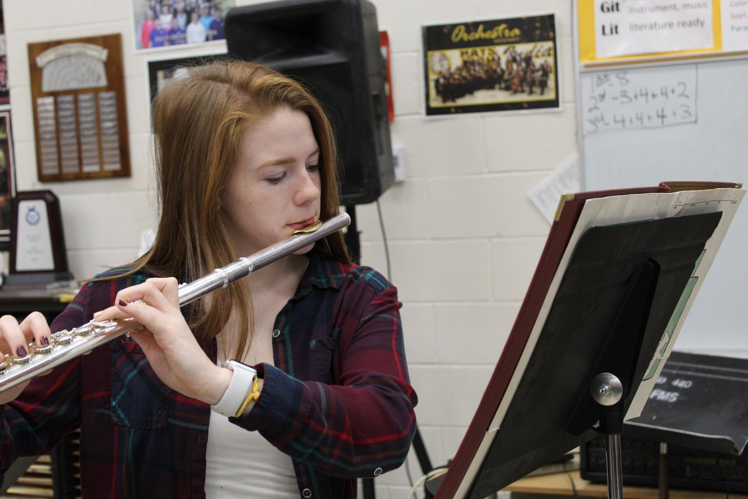 During PRIDE Time, senior Paige Beamer practices the KMEA District Band music in the band room. Beamer received second chair in the flute section for KMEA.