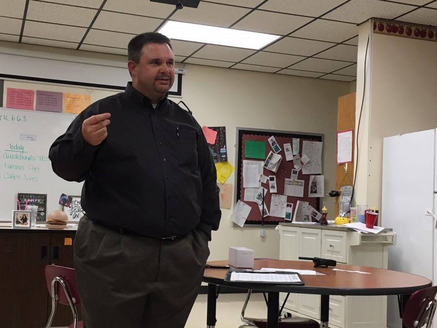 Chief Lending Officer for Bank of Hays Brandon Prough visits with students on Nov.8