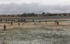 The Boys' soccer team plays Ark City at home on Oct. 28. The weather was not very pleasant for a soccer match, with snow falling through the duration of the match.