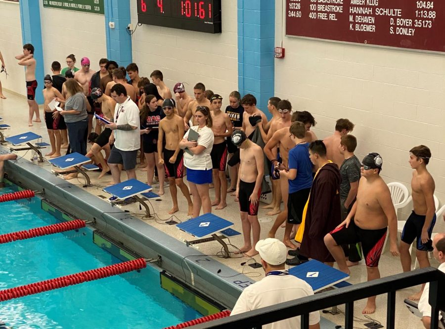 The teams gather as each team prepares for the 100 yard breastroke. The boys who swam in this event were junior Fernando Zarate, and freshmen Kaden McBride, Jude Tippy, and Ashton Bickle.