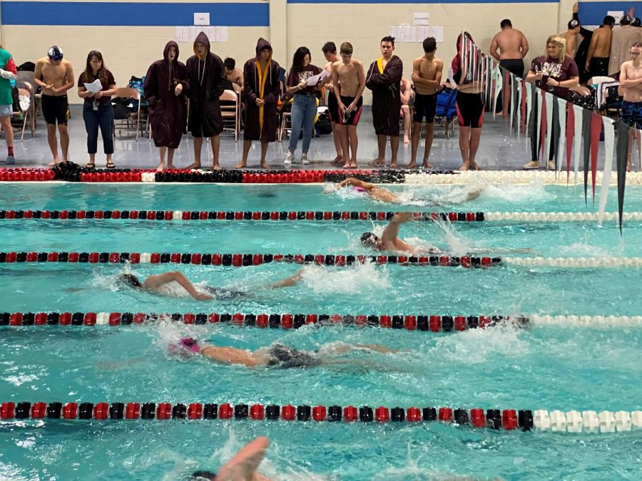 Members+of+the+Swim+team+cheer+on+teammates+during+the+Great+Bend+Invitational.
