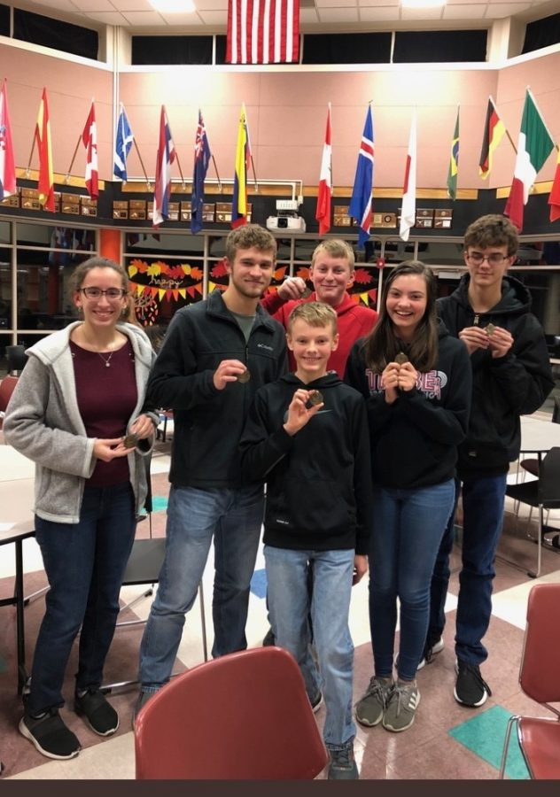 Scholars+Bowl+members+pose+with+their+first+place+medals+after+the+Colby+Invitational+meet+on+Dec.+9.+The+team+beat+Scott+City+in+the+finals+with+a+score+of+90-50.