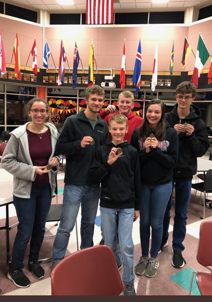 Scholars Bowl members pose with their first place medals after the Colby Invitational meet on Dec. 9. The team beat Scott City in the finals with a score of 90-50.