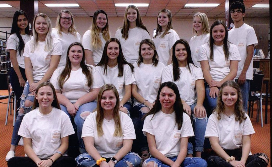 The 2019-2020 Indian Call staff poses for a picture. The staff pictured above along with adviser Bill Gasper worked on the edition of the Indian Call which has now been given the title of All-Kansas Yearbook.