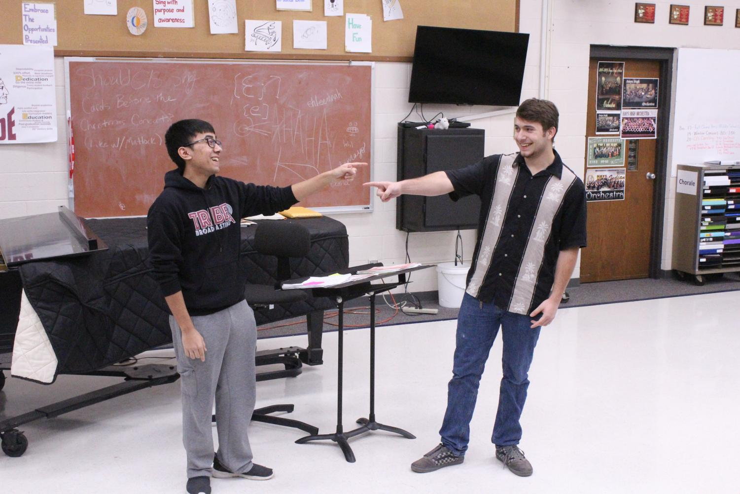 Senior Derrick Aragon and junior Eythun Wyatt perform in front of the panel of judges for the talent show auditions.