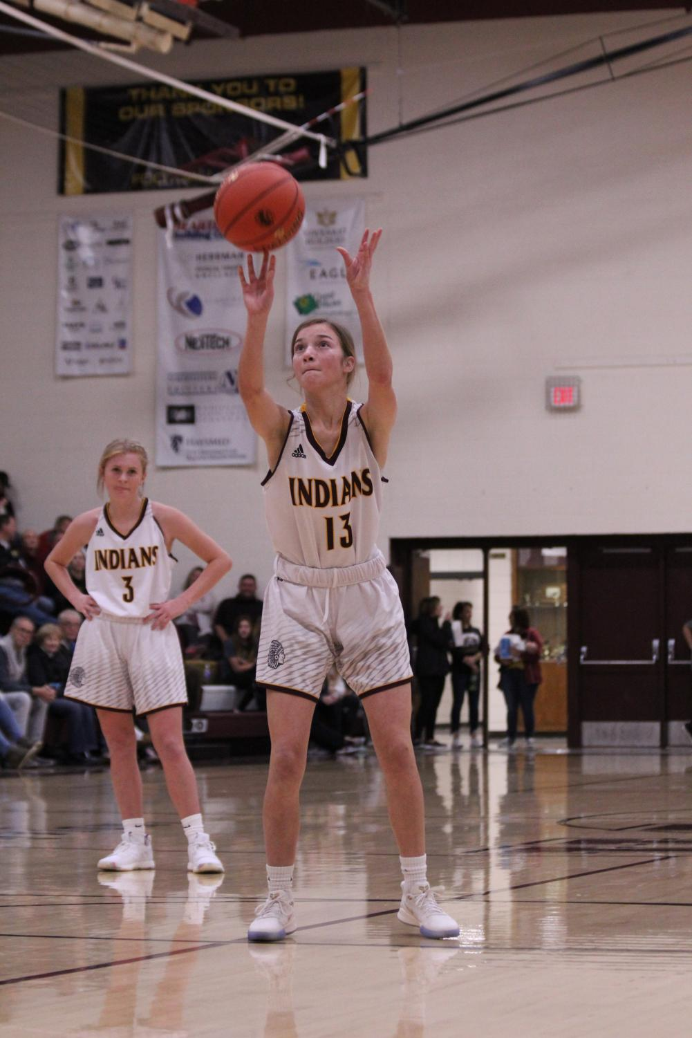 Freshman Carly Lang shoots a free-throw during the game against Life Prep at home.