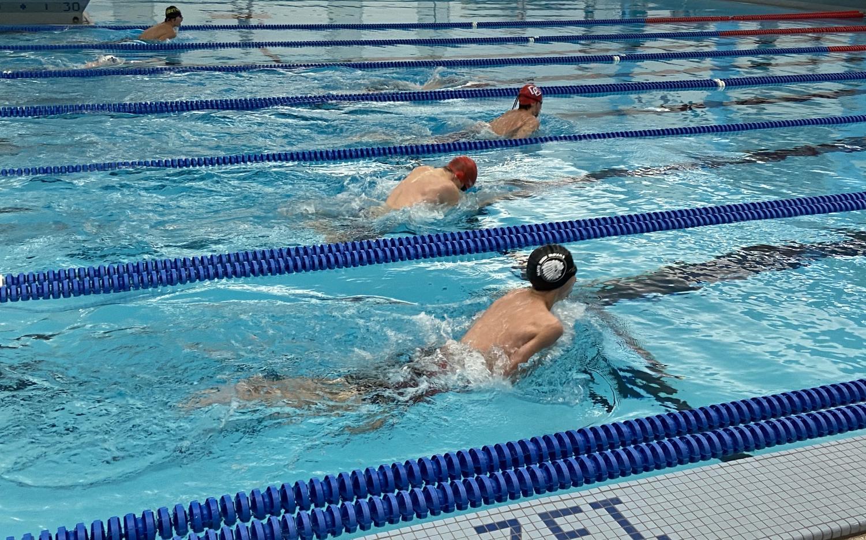The swim boys rush to finish their breast stroke race.