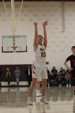 Sophomore Noah Weimer shoots a free throw during the home game against Great Bend on Jan. 14.