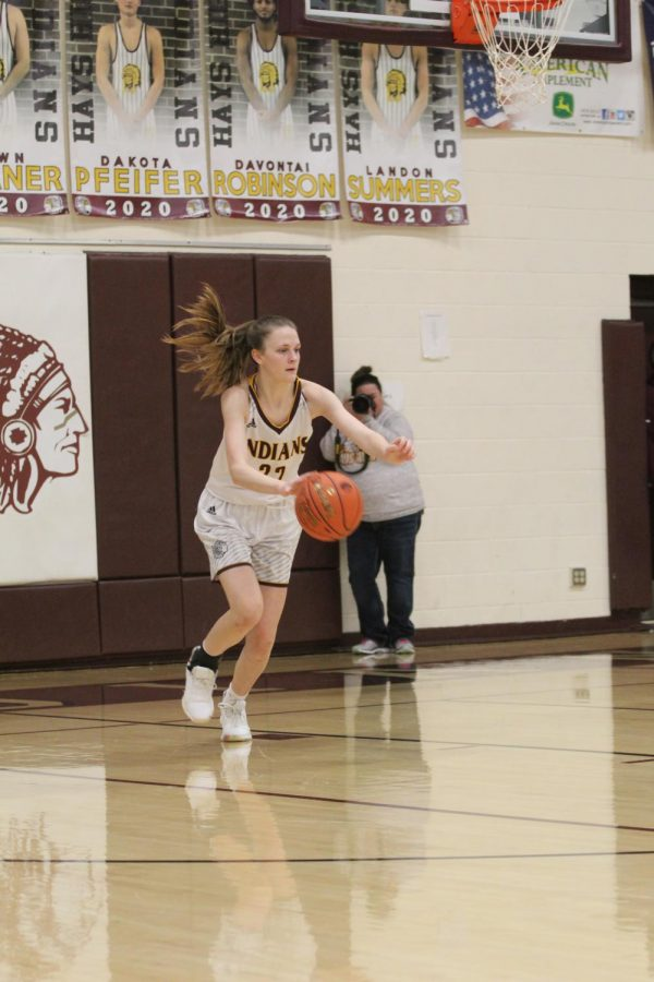 Sophomore Aleyia Ruder dribbles the ball down the court during the home game against Great Bend on Jan. 14.
