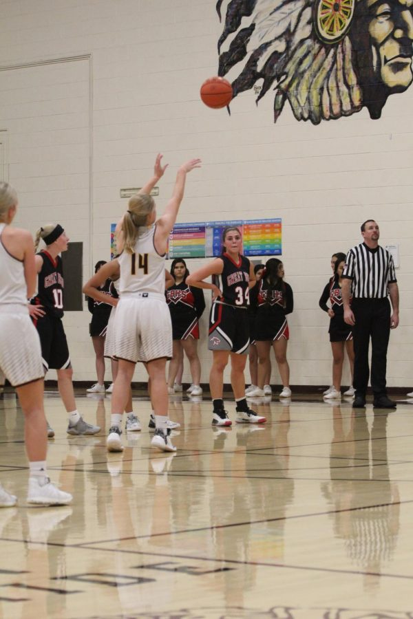 Senior Isabel Robben shoots a free throw during the home game against Great Bend on Jan. 14.