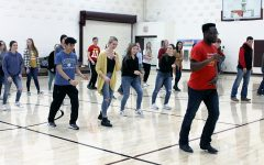Barn Hoppers teach students how to swing/line dance during PRIDE Time