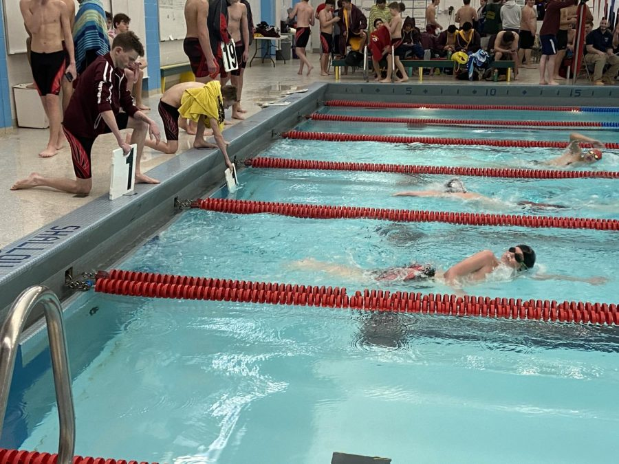 Freshman Jude Tippy on his first lap in the 500 freestyle event.