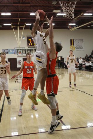 Junior TJ Nunnery goes up for a layup during the home game against Abilene on Feb. 18.