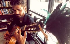 Artist, writer and classical guitarist Joshua Merello performs in