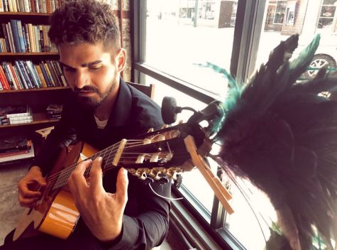 "Artist, writer and classical guitarist Joshua Merello performs in ""The Dusty Bookshelf"" book store in Manhattan, Kan. Merello, who had played guitar as a hobby in and out of different bands, began taking music seriously at the beginning of 2018 when his father was diagnosed with terminal cancer. The family struggled to express their emotions in words, but through playing guitar for his parents during that time, Merello found he was able to pour both his joys and struggles into his music."