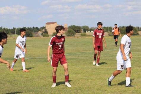 Sophomores Trayton Roa and Hector Amaya watch as the Garden City Buffaloes set up for a throw in during the game on Sept. 1.