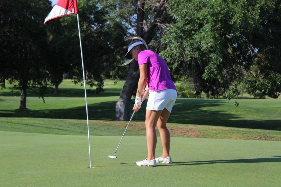 Senior varsity member Sierra Smith makes a putt at the Smoky Hill Country Club.