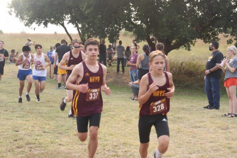 Freshmen Logan Chance and Everett McClure compete in the Boys JV race.