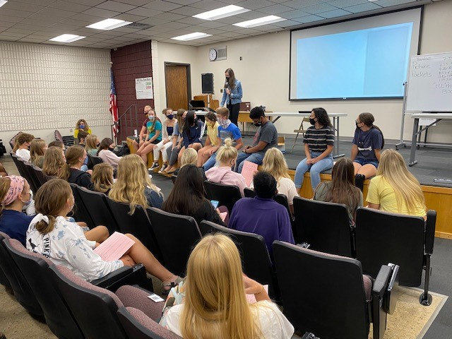 Student Council president Alicia Feyerherm presents homecoming plans for this school year.