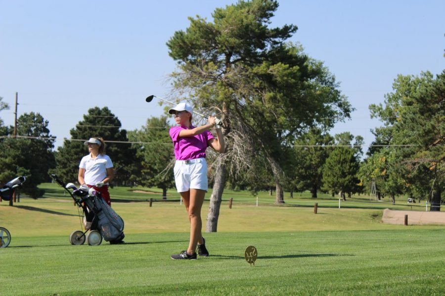 Sophomore Katie Dinkel shoots off the tee box on hole 10 at the Smoky Hill Country Club at the Hays High Invitational Golf tournament.