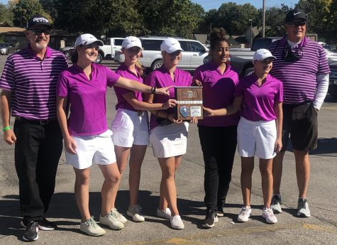 The HHS varsity girls golf team poses for a picture with their new trophy. From left to right, Assistant coach Doug Lowen, senior Sophie Garrison, sophomore Katie Dinkel, senior Sierra Smith, junior Taleia McCrae, freshman Abbie Norris and coach Mark Watts.