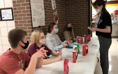 Junior Class Co-Vice-President Tyler Solida and StuCo members Jocelyn Rigler, Sydney Wittkorn, and Hayli Meier sell candy canes to sophomore Maysyn Tippy.