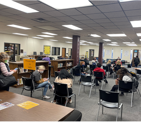 Students and parents enroll for spring concurrent credit on Jan. 13 in the Hays High library.