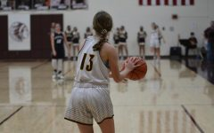 Sophomore Carly Lang looks for an open teammate while in bounding the ball in the game against Thomas More Prep during the Hays City Shootout on Dec. 5.