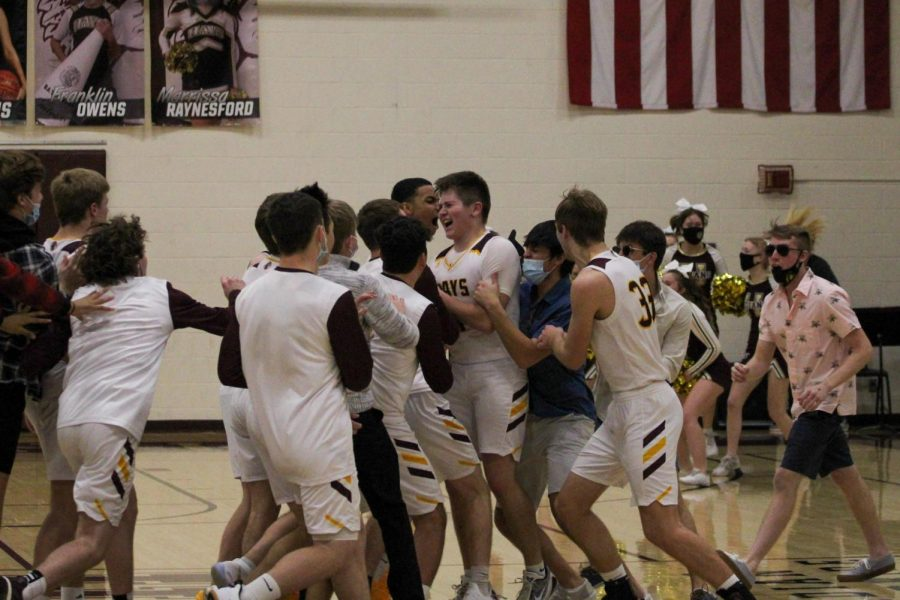 Junior Carson Kieffer celebrates with teammates after a last second shot against Salina Central on January 29th.