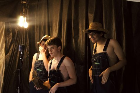 "Seniors Gabe McGuire, Tom Drabkin, and Andrew Duke (left to right) line up in their order as the opening act in the 2021 Cabaret. The trio performed ""Man of Constant Sorrow"" from O Brother, Where Art Thou, set in rural Mississippi in 1937."