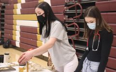 Junior McKinley Wamser (left) and senior Katie Christen (right) talk to eighth graders at the Future Medical Professionals table. Eighth graders had 45 minutes to visit each of the tables and learn about the variety of opportunities available at the high school.