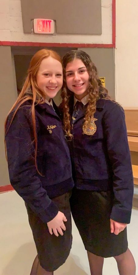 Sophomores+Amelia+Jeager+and+Karli+Neher+pictured+at+an+FFA+event+in+their+official+dress.+