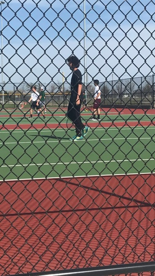 The Boys varsity tennis team competes at Salina South and Garden City against tough competitors.