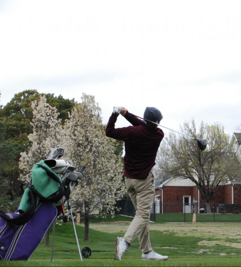 Sophomore Braden Hoskins hits a drive from the tee box on hole 17 at the annual Smoky Hill Country Club high school tournament.