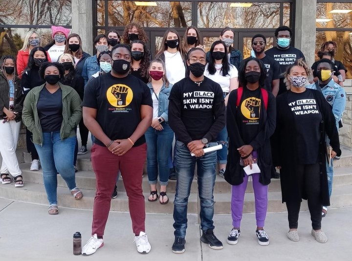 The group who marched to the SGA meeting wore black, and allies wore white.
