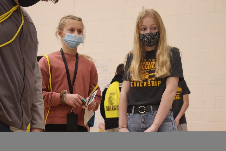 Junior Jocelyn Rigler shows her eighth grade group all of the clubs organizations Hays High has to offer on March 5.