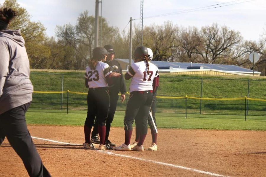 Assistant Coach Ty Berry Talks to some members of the softball team during a timeout called by Great Bend during the game that the Indians hosted on April 22.