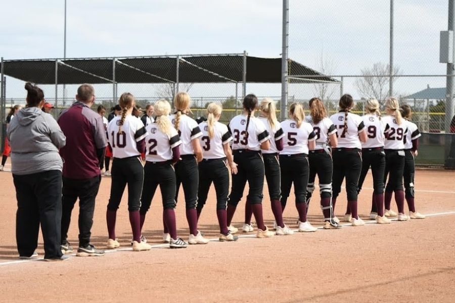 The Lady Indians stand for the national anthem before their final game of the week against Liberal. They would go on to win with a walk off in the bottom of the eighth inning.