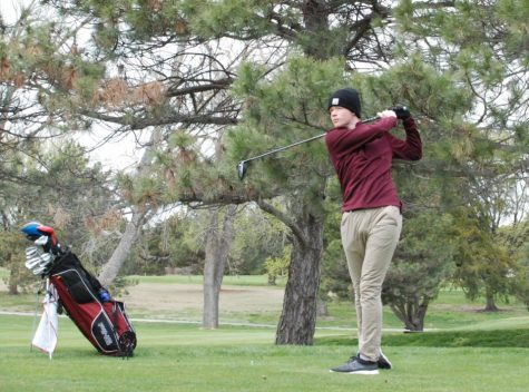 Senior Skylar Zimmerman hits of the tee box on hole 9 at the Hays Invitational tournament.