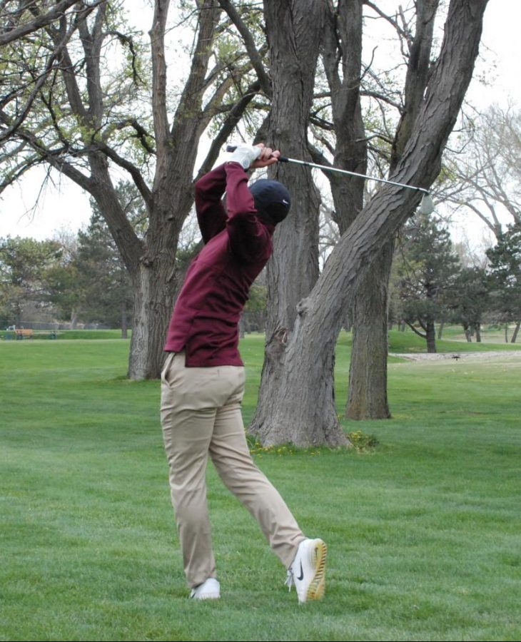 Junior Ashton Hernandez hits his nine iron on the 10th hole at the Smoky Hill Invitational tournament in Hays.