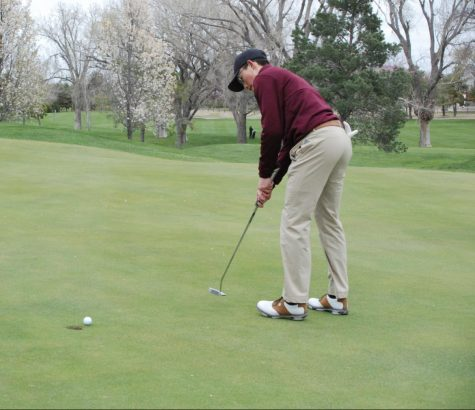 Senior Jason Krannawitter two-putts on the back nine at the Hays Invitational Tournament at Smoky Hill Country Club