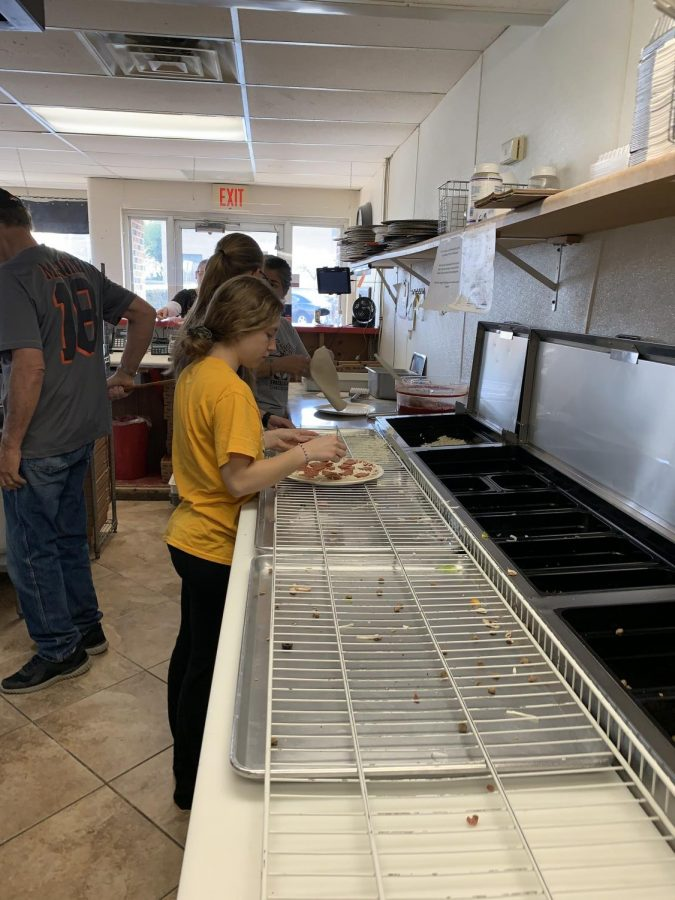 Kelly Parr makes a pepperoni pizza at Lomatos pizza on April 24. She was there to raise money for a trip to France, Germany, Portugal and Spain in June 2022.