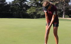 Senior Gracie Wente putts on hole 6 at Smoky Hill Country Club
