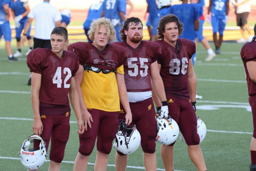 The Indians defensive line stands and observes while the offense is participating in the annual Maroon and Gold Scrimmage and the Jamboree. The defensive line is led by a majority of juniors and seniors.