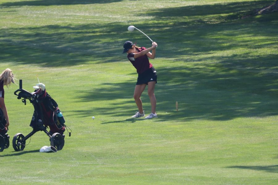 Junior Aspen Melvin hits her driver at the Hays High Invitational Tournament at Smoky Hill Country Club.