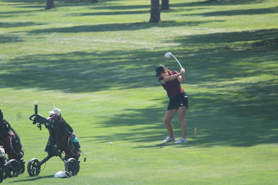 Junior+Aspen+Melvin+hits+her+tee+shot+on+hole+2+at+the+HHS+golf+tournament.
