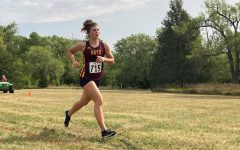 Junior Amelia Jaeger races at the Great Bend meet on September 2. Jaeger finished third at the Hesston meet with a time of 24:03:00.