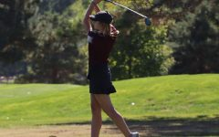 Senior Gracie Wente hit her tee shot at the TMP Invitational Tournament at Smoky Hill Country Club.