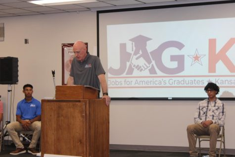 Current head of the Hays High JAG-K, Bryan Zollinger, speaks in the lecture hall.