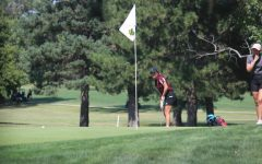 Junior Claire Humphrey watched her putt at the Hays High Invitational Tournament at Smoky Hill Country Club.